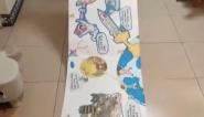 """北京:小学生用月饼盒制3米""""天宫图""""致敬航天员"""